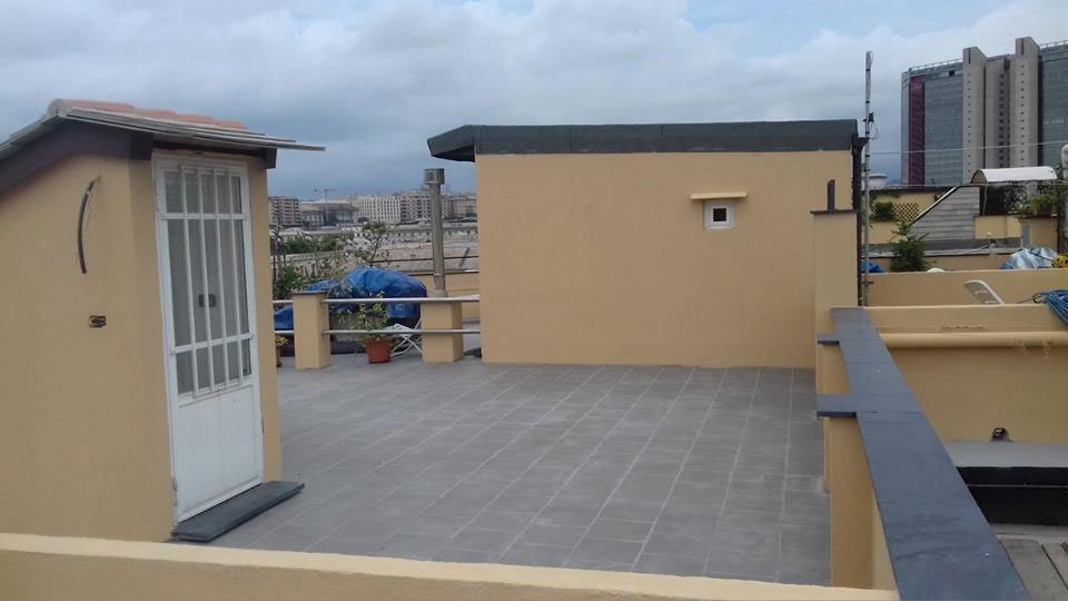 Terrazzo-copertura-piana-con-pavimento-piastrelle-dopo